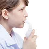 Girl inhales with mouthpiece of jet nebulizer Royalty Free Stock Photo