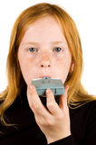 Girl inhaling asthma medicine Royalty Free Stock Images