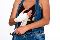Girl with an injured hand Royalty Free Stock Image