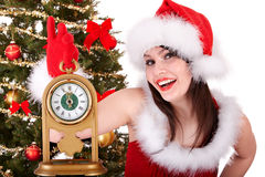 Girl insanta hat and fir tree with clock Stock Images