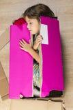 Girl inside a cardboard box Stock Photos