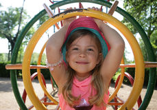 Girl inside climbing frame Royalty Free Stock Photo