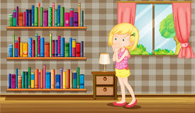 A girl inside a house full of books Stock Photo