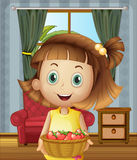 A girl inside the house holding a basket of strawberries Stock Images