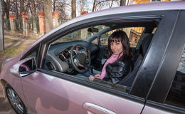 Girl inside pink car. Girl with pink scarf inside pink car Stock Photography