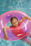 Girl Inside Pink Float Tube In Pool Stock Photos