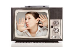 Girl inside a retro television. Girl inside a retro portable television on white background Royalty Free Stock Photos
