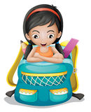 A girl inside a school bag Stock Images