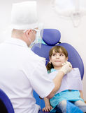 Girl  during inspection of oral cavity Royalty Free Stock Photo