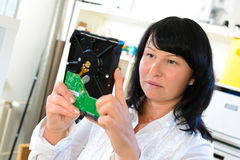Girl install HDD Disk Drive. Woman Royalty Free Stock Images