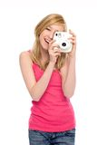 Girl with instant camera Stock Image
