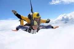Tandem jump. Skydiving in the blue sky. stock photo