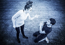 Girl insulting boyfriend. Girl assaulting and insulting boyfriend in park Stock Photo