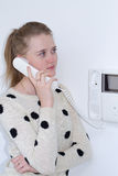 Girl with intercom Stock Images