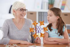 Girl interested in paper windmill Stock Photo