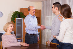 Girl introducing boyfriend to parents Royalty Free Stock Image
