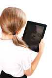 Girl with ipad like gadget. Isolated white background royalty free stock images