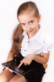 Girl with ipad like gadget Stock Photos