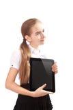 Girl with ipad like gadget Stock Photography