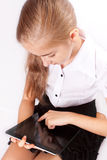 Girl with ipad like gadget Stock Photography
