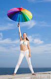Girl with iridescent umbrella on background of sky Stock Images