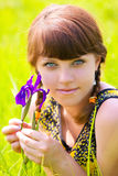 Girl with iris Stock Image