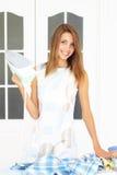 girl ironing Stock Image