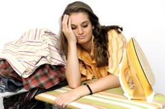 Girl at ironing board Royalty Free Stock Photos