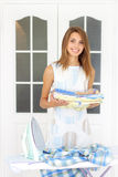 Girl ironing clothes Stock Images