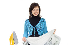 Girl ironing clothes Stock Photography