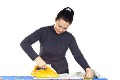 Girl ironing clothes Royalty Free Stock Photography