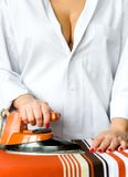 A girl ironing clothes with an old iron. royalty free stock photos