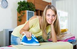 Girl ironing at home Stock Photos