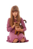 Girl irons cat Stock Images