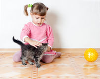 The girl irons a kitten Royalty Free Stock Photos
