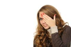 Girl Is Gazing Through Her Fingers