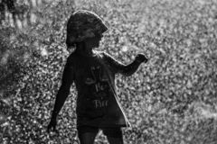 Free Girl Is Having Fun In Water In Park, Hot Summer In Garden, Girl Running In Water Drops,happy And Cheerful Girl Enjoying Cold Water Stock Images - 126818824