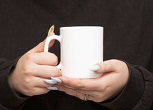 Free Girl Is Holding White Cup In Hands Stock Image - 204502031
