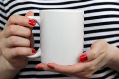 Girl Is Holding White Cup In Hands. Stock Photo