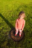 Girl Is Standing On Hatch In Grass Royalty Free Stock Image