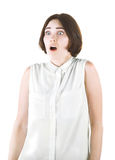 A girl isolated on a white background. Shocked girl. Scared professional lady. Brunette young woman in a blouse. Royalty Free Stock Images
