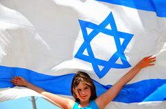 Israel flag. A girl with Israel flag stock photography
