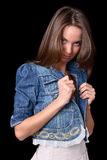 Girl in jacket. Modest girl lap jean jacket Stock Image