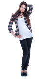 Girl in jacket. Standing on a white background Royalty Free Stock Images