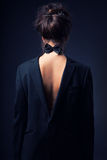 Girl in a jacket and bow tie Royalty Free Stock Photos