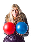 Girl in a jacket holding balls Stock Photo