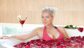Girl in jacuzzi. Happy girl in jacuzzi having a good time Royalty Free Stock Photography