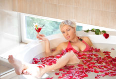 Girl in jacuzzi. Happy girl in jacuzzi having a good time Royalty Free Stock Photo