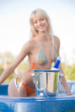 Girl in Jacuzzi, focus on champagne bottle Royalty Free Stock Photography