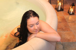 Girl in the jacuzzi Stock Photos